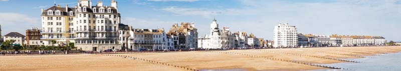 Eastbourne beach and seafront as seen from the pier in East Sussex UK
