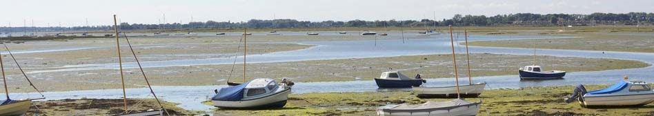 Boats on beach at low tide in Emsworth. Hampshire. United Kingdom