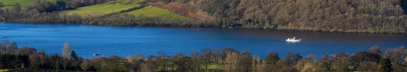 Ullswater steamer travelling towards Pooley Bridge in the Lake District National Park East Cumbria